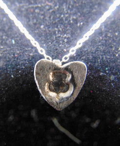 Fine silver pendant with claddagh stamped impression