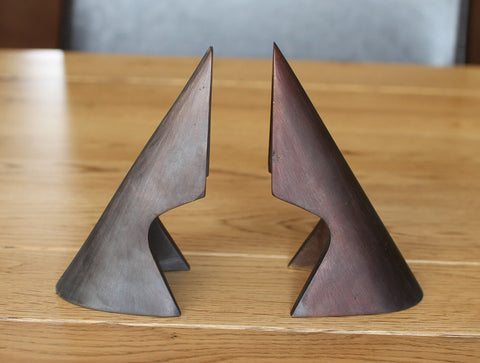 Cutaway Triangle Bookends by Carl Auböck