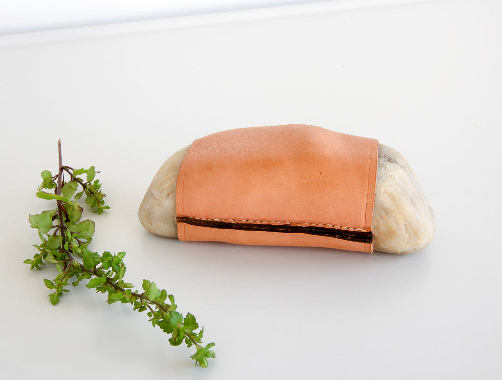 Stone with Leather Cover by Carl Auböck at OEN Shop