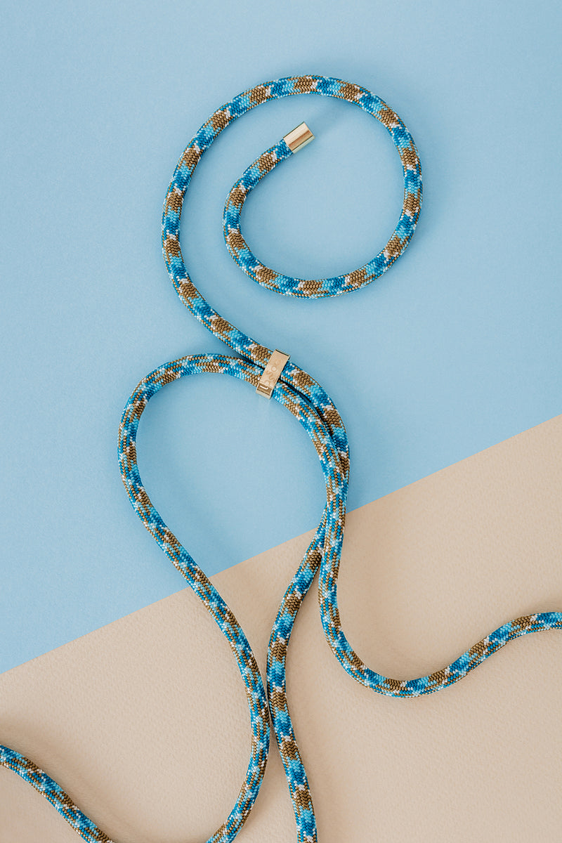 Lassoo Desert Blue Cord accessory. Exchange the Cord on your smartphone necklace to match any fashion outfit.