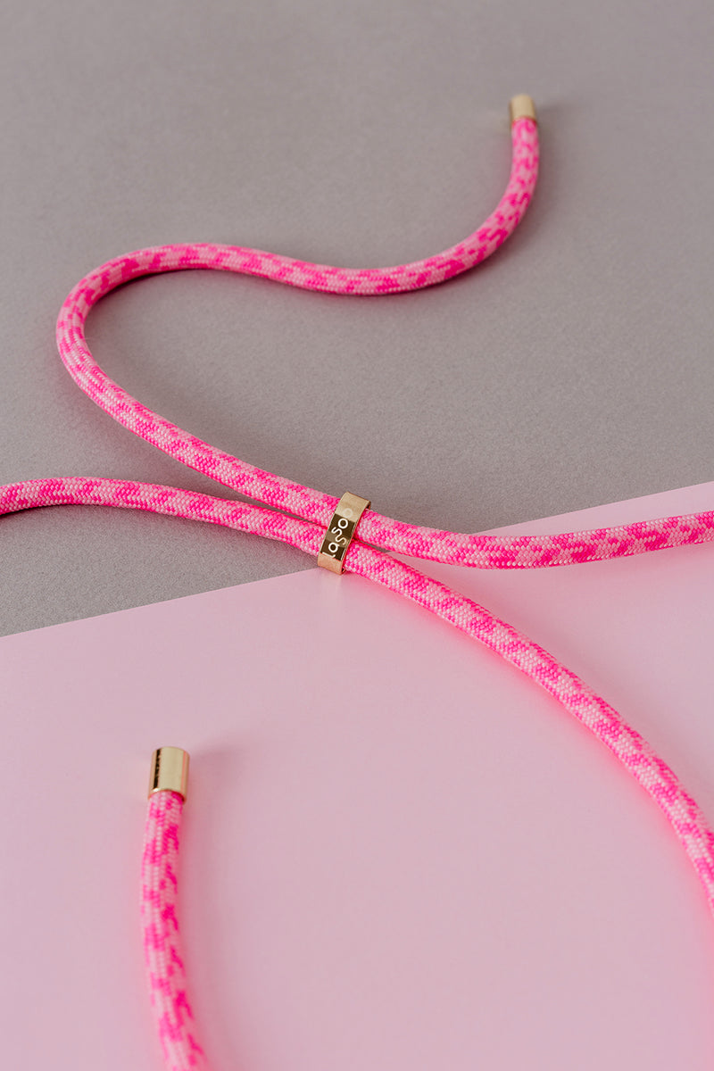 Lassoo Pink Punch Cord accessory. Exchange the Cord on your smartphone necklace to match any fashion outfit.