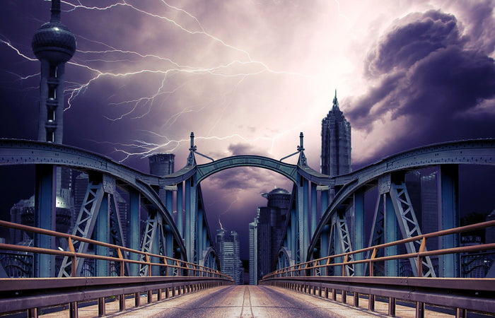 Three seperate lightning bolts captured above the bridge on a stormy day