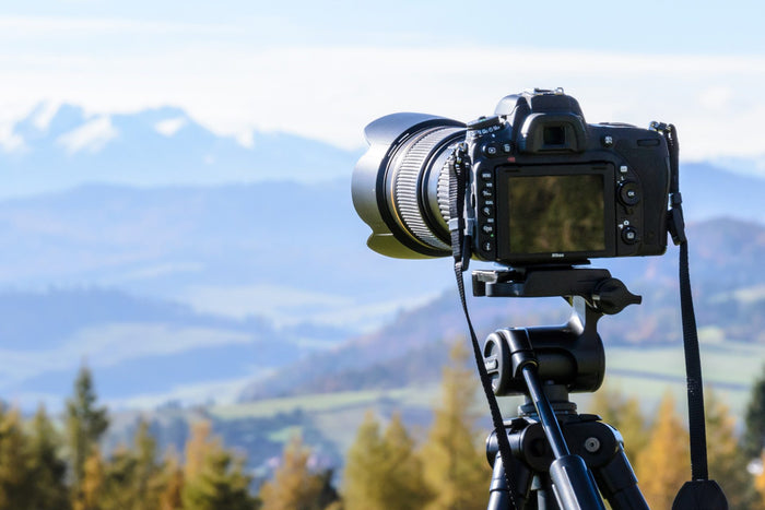 A DSLR pointed towards the view, to capture a timelapse video