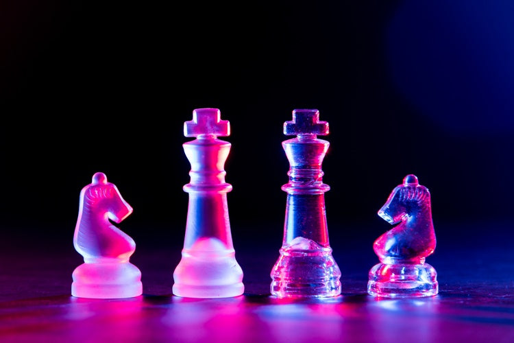 portrait of some chess pieces taken with red light