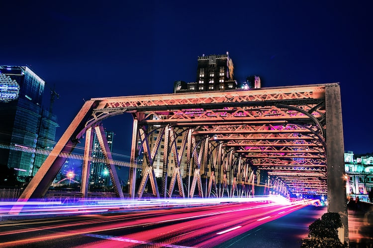 cars passing on the bridge by night