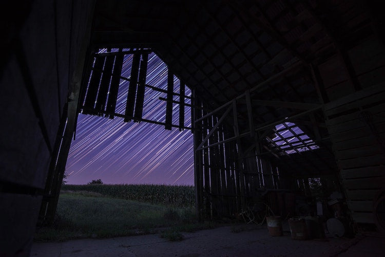 star trails shot at a barn