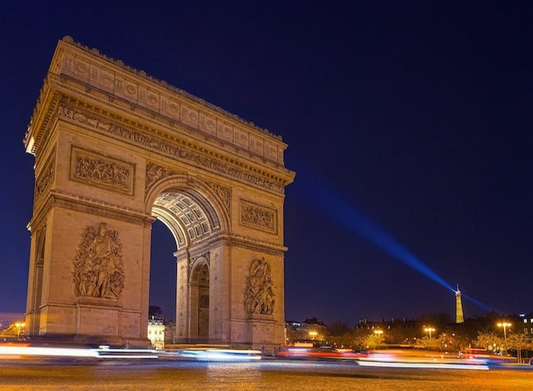 cars passing by arc de triumph at Paris