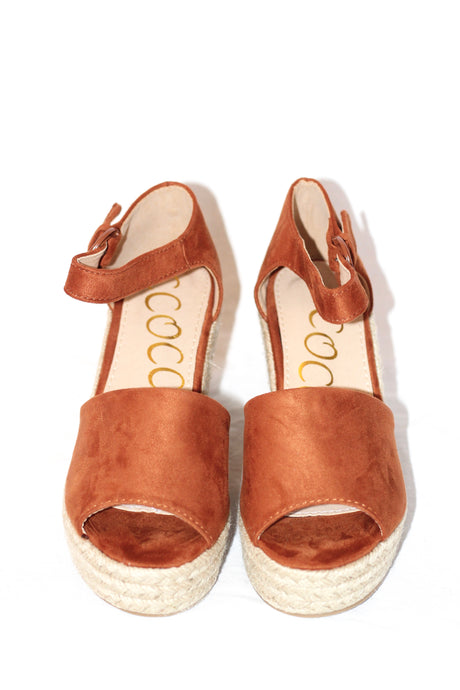 Rusty orange wedges. Ankle strap make for support and comfort.