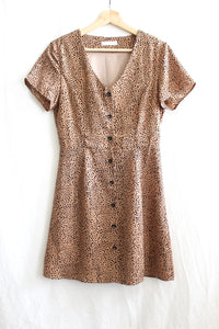 Bohemian leopard print button-up dress.