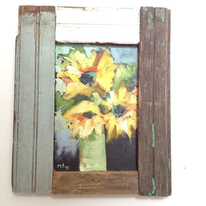 Abstract sunflowers in oil on a wood panel with a barn wood frame.