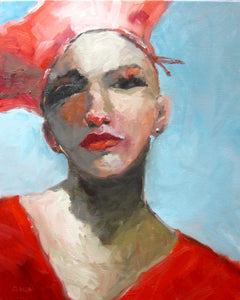 Portrait of a woman in a red hat.