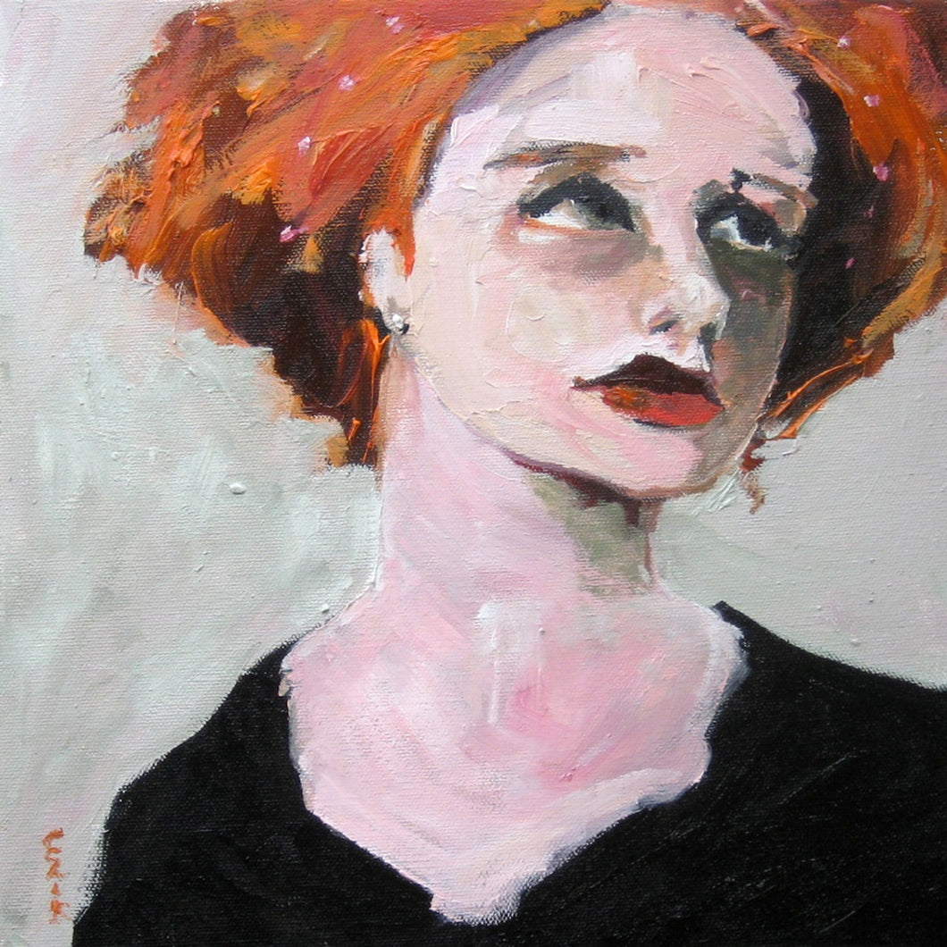 Red head female in a black dress.