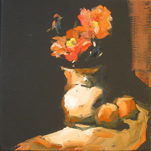 Orange zinnias and fruit in still life.