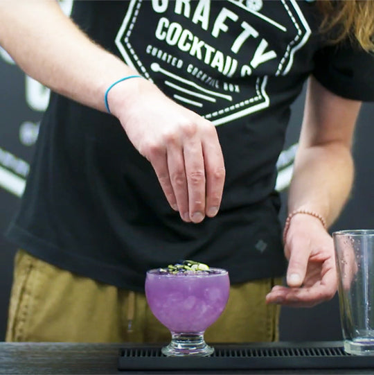 A crafty cocktails team member preparing a cocktail.