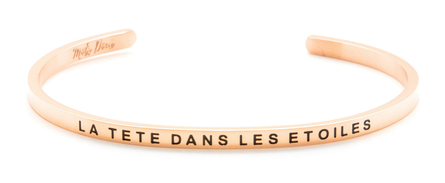 Inspirational French message bracelet, with Mots Doux, wear your French inspiration daily! Cute cuff reminder engraved with French words of positivity and encouragement. Minimalist, elegant bracelet promoting an optimism and positive lifestyle. Be different, be unique say it in French. CROIS EN TOI, BELIEVE IN YOURSELF. French mantra. LA TETE DANS LES ETOILES_THE HEAD IN THE CLOUDS