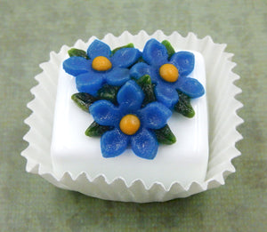 Blue Flax atop a White Petit Four Chocolate
