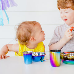 Adorable toddler girl and her brother using their Ahimsa stainless steel dishwater.
