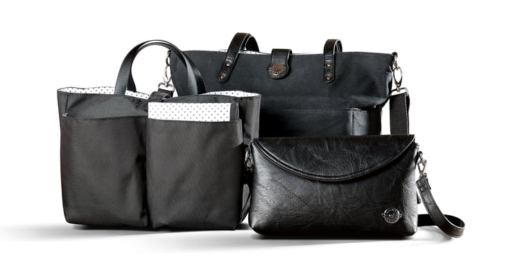 Black Carry All Tote Trio shown with three included components; black waxed canvas tote, black vegan leather diaper clutch a black multi-pocket organizer insert with carry handles.