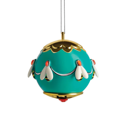Alessi home ornament in porcelain, hand decorated as a gold and teal ball encircled by bees.