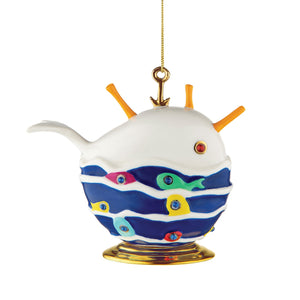 Alessi home ornament in porcelain, hand decorated as a whale with a school of fish.