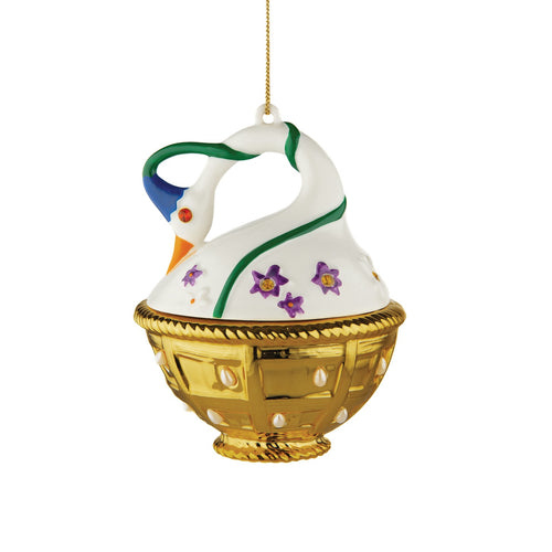 Alessi home ornament in porcelain, hand decorated as a swan in a basket with spring flowers.