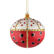 Alessi home ornament in porcelain, hand decorated as a royal embellished lady bug (front side).