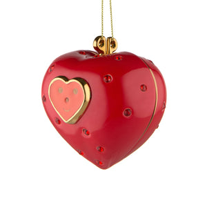 Alessi home ornament in porcelain, hand decorated as a red heart, embellished with a face. Has two halves.