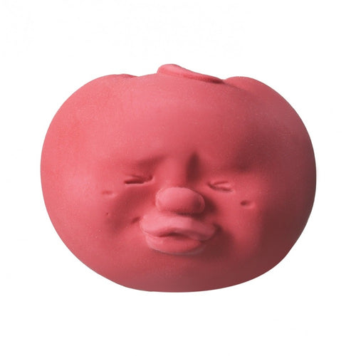 Stress ball with a funny face in the shape and color of a red tomato.