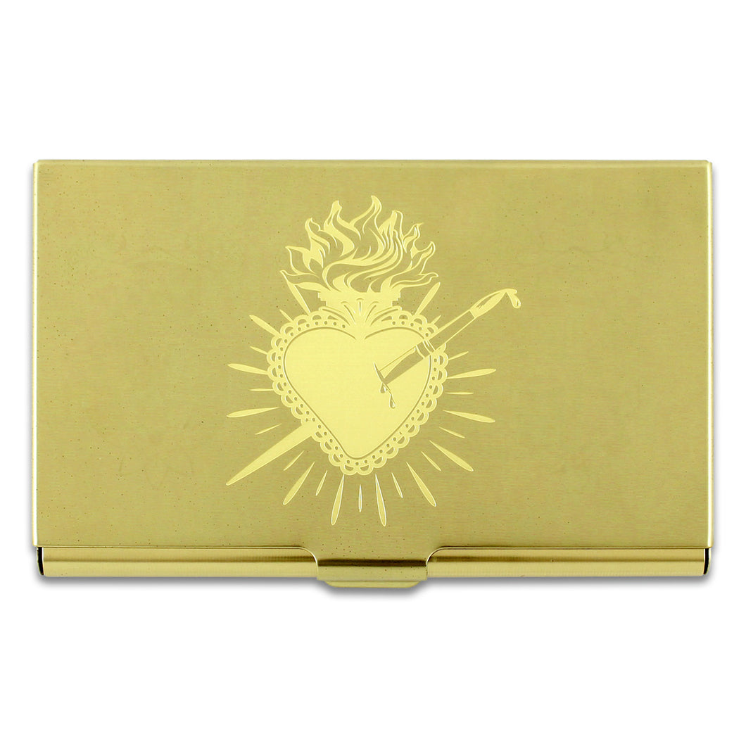 Heart design by Frida Kahlo on a brass colored mirror chrome finished metal card case.