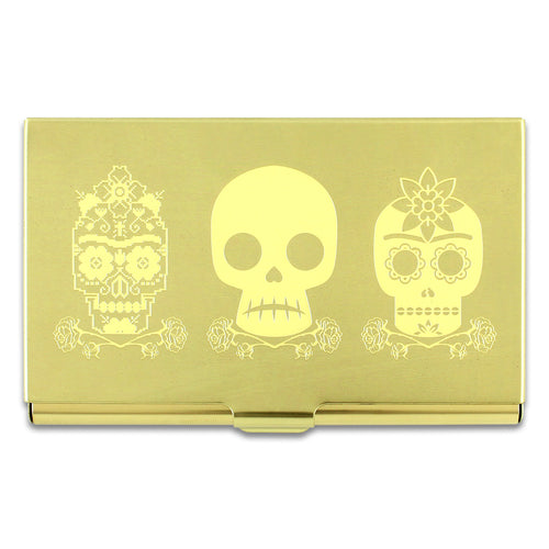 Skulls design by Frida Kahlo on a brass colored mirror chrome finished metal card case.