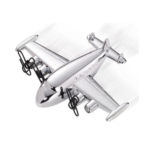 Chrome-plated paperweight and desk object in the shape of a plane with a magnetized propeller.