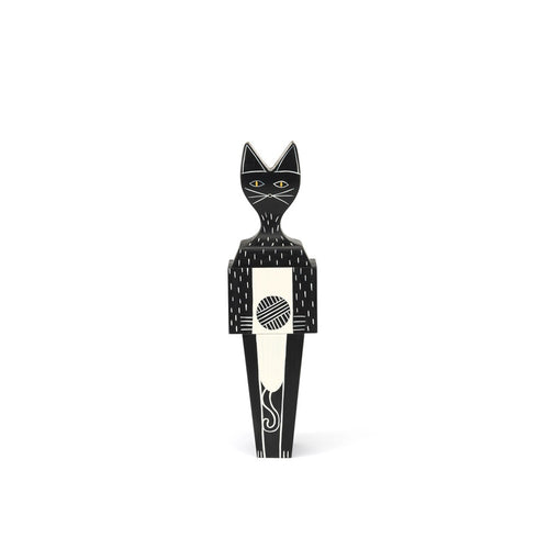 The small cat doll is made out of solid fir and is hand painted to a black finish. Made out of 3 separate pieces combined to make a doll.