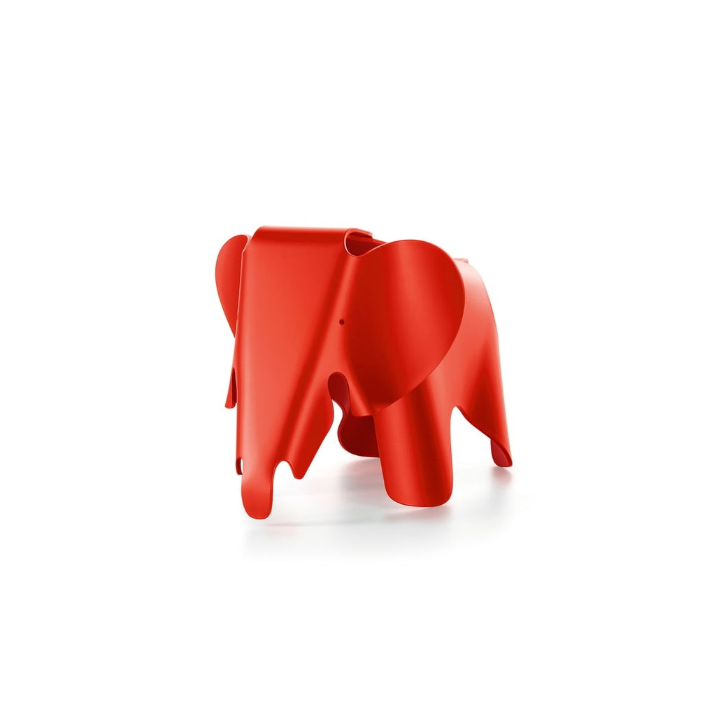 Red plastic elephant designed by Charles and Ray Eames.