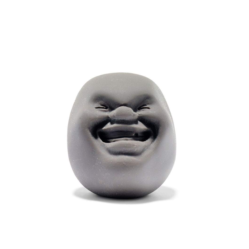 Stress ball with a funny face designed by Makiko Yoshida. Hand made in Japan.