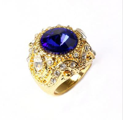 SMASHING YELLOW GOLD PLATED ALLOY RING WITH DEEP BLUE CRYSTAL