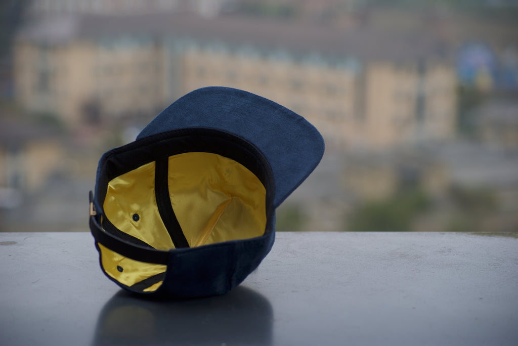 Urban Panda Blue Suede strap back cap with gold lining