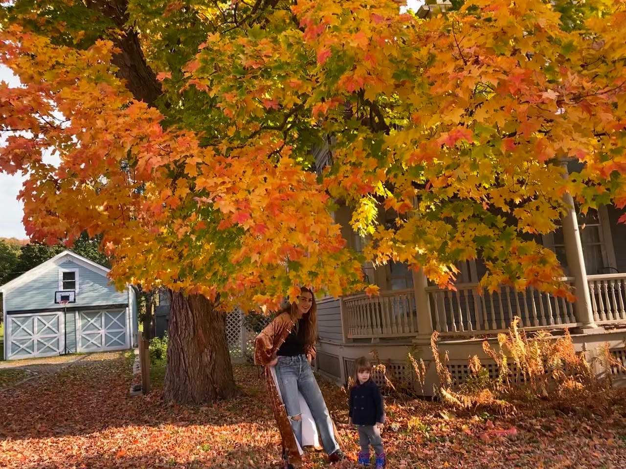 Yali supporter, Lola, playing with her daughter in the fall foliage