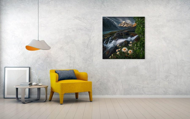 Mount Cook Print hanged in living room wall displaying flowers and a waterfall in summer