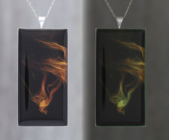 Phoenix Diving! Glow in the dark pendant featuring coloured smoke -  Beautiful abstract image showing science  of air patterns