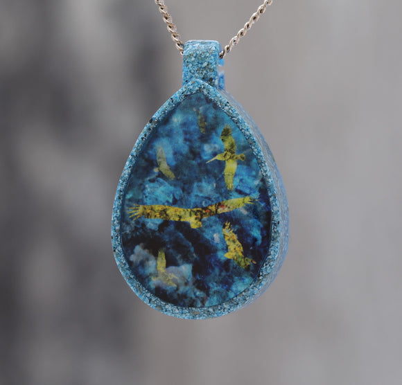 Flying by the Seaside  - Glow-in-the-dark pendant with a beautiful abstract bird pattern