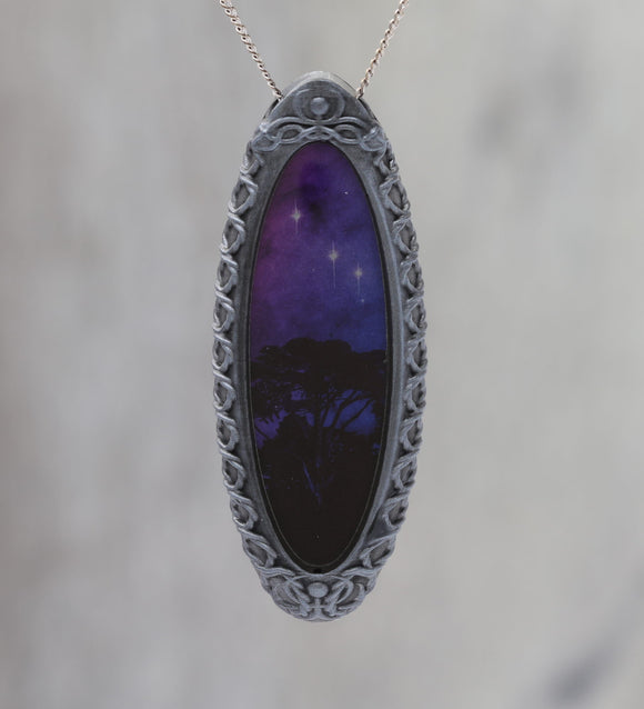 Trees Dreaming - Galaxy Pendant with Celtic Knotwork  and made with a photo of a tree and the Carina Nebula!