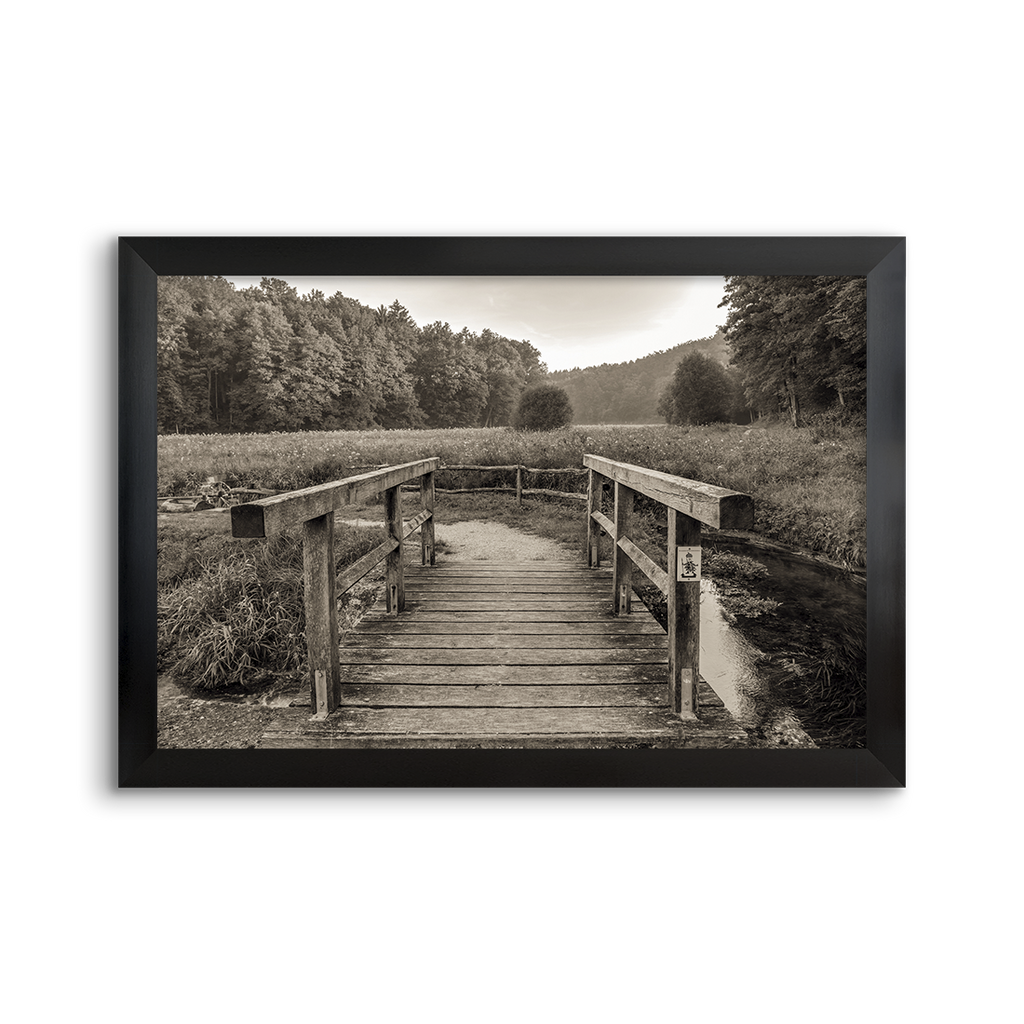 wooden bridge over a small creek