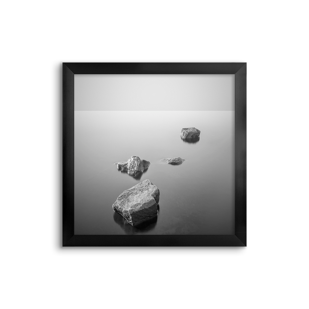 rocks in a still lake