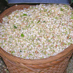 A basket full of jasmine flower petals used to make perfume essential oil