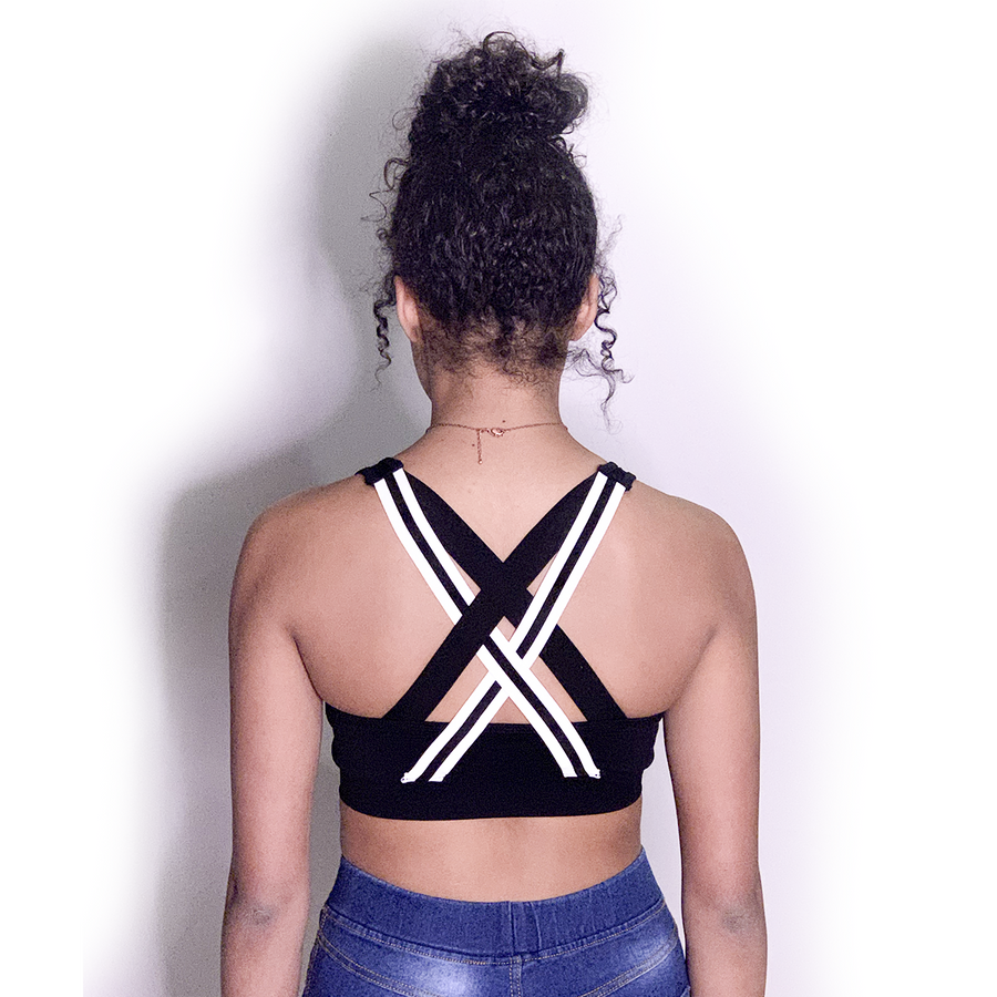 BLACK SPORTS BRA W/ WHITE GLITTER UNITY MARK & BLACK/WHITE CRISS CROSS BACK