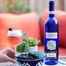 Bartenura Moscato on Table -Lifestyle Photo