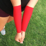 red forearm compression sleeves for volleyball beach play