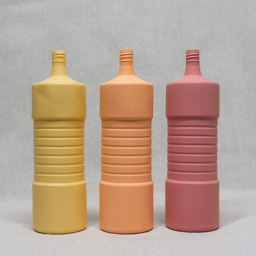 Ribbed Bottle Vase home decor in orange, butter, and beet.