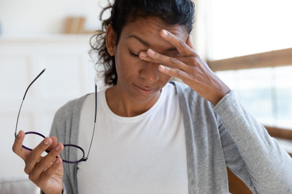 African American woman with dizziness or headache
