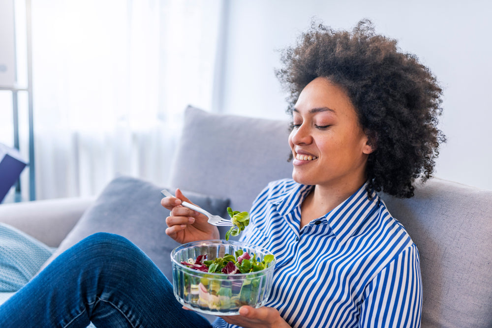 African American woman eating a salad